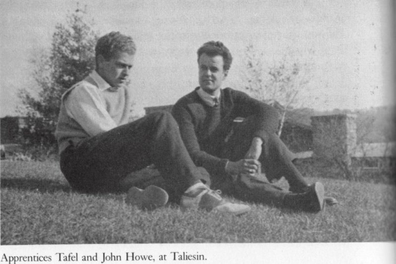 Black and white photograph of apprentices Edgar Tafel and Jack Howe sitting on Taliesin's Hill Crown.
