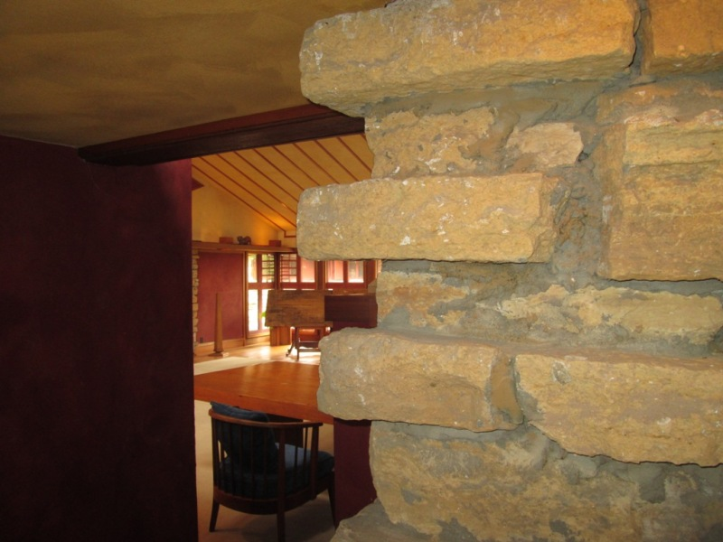 Stone wall in Wright's private office with this studio in the background.