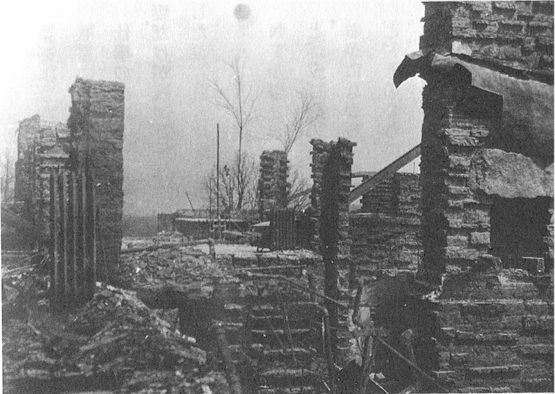 Photograph looking across the main floor after Taliesin II was destroyed by fire in 1925.
