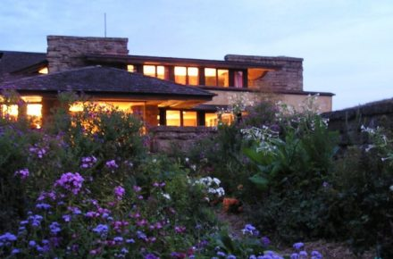 Looking at the east facade of Taliesin at dusk.