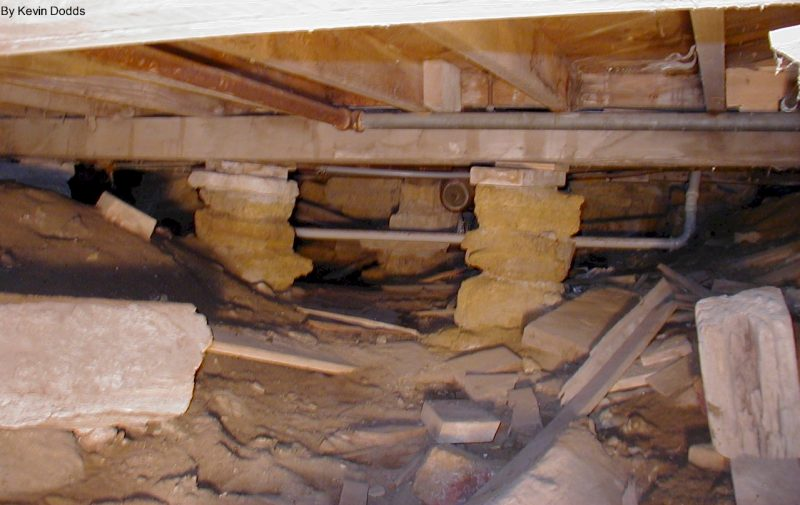 A crawlspace with dirt and stone piers underneath Taliesin