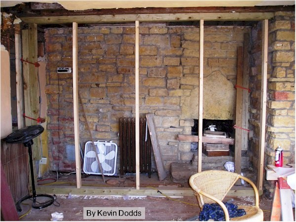 """Photograph of a fireplace in the room at Taliesin known as """"the Gold Room""""."""