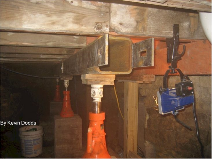 Looking at a new beam in Taliesin's crawlspace