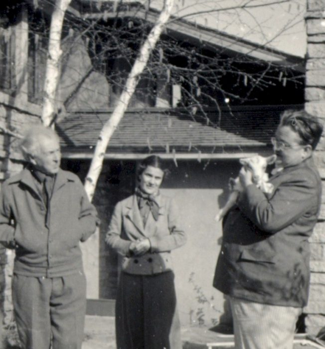 Frank and Olgivanna Lloyd Wright outside at Taliesin with Alexander Woollcott holding baby goat.